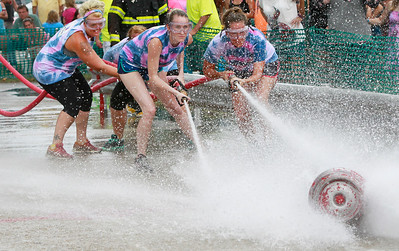 Candace H. Johnson North Shore Spinal & Sports Rehabilitation's Lauren Barkley, of Fox Lake, Christin Hoekstra, of Round Lake and Mallery Drozd, of Fox Lake take the lead pushing the barrell with their hose against the Lake Villa VFW team in the water fights during Lake Villa Days at Lehmann Park in Lake Villa. Tari Olsen and Lanaya Gutowski, both of Lake Villa were also part of the North Shore Spinal team.