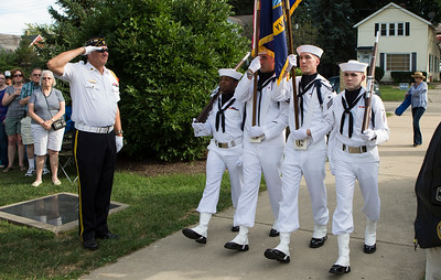 "Mike Greene - For Shaw Media  The colors are presented by members of the Navy Color Guard at Captain James A. Lovell Federal Health Care Center during McHenry's seventh annual event celebrating the end of World War II Sunday, August 14, 2016 at Veterans Memorial Park in McHenry. The annual event included swing music by  Bill's Little Big Band, Military Honor Guard Salute with ""Taps"" played by 18 Buglers as well as a 21 white dove release."
