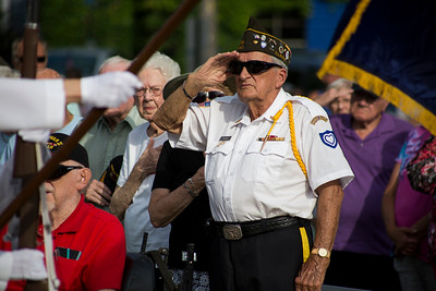 "Mike Greene - For Shaw Media  WWII Veterans and attendees salute the flag during McHenry's seventh annual event celebrating the end of World War II Sunday, August 14, 2016 at Veterans Memorial Park in McHenry. The annual event included swing music by  Bill's Little Big Band, Military Honor Guard Salute with ""Taps"" played by 18 Buglers as well as a 21 white dove release."