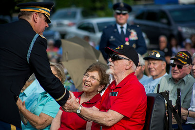 "Mike Greene - For Shaw Media  WWII Veteran Army Sergeant Joe Vokaty, right, shakes hand with Army Lieutenant Colonel Lee Lexow while receiving a coin commemorating his sevice during McHenry's seventh annual event celebrating the end of World War II Sunday, August 14, 2016 at Veterans Memorial Park in McHenry. The annual event included swing music by  Bill's Little Big Band, Military Honor Guard Salute with ""Taps"" played by 18 Buglers as well as a 21 white dove release."