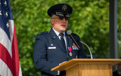 "Mike Greene - For Shaw Media  Retired  USAF Colonel Craig Wilcox speaks during McHenry's seventh annual event celebrating the end of World War II Sunday, August 14, 2016 at Veterans Memorial Park in McHenry. The annual event included swing music by  Bill's Little Big Band, Military Honor Guard Salute with ""Taps"" played by 18 Buglers as well as a 21 white dove release."