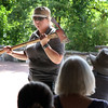 Park manager Trish Burns holds an ax while talking about prescribed burns during a class at Peck Farm Park in Geneva on August 14.