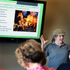 Park manager Trish Burns talks about prescribed burns during a class at Peck Farm Park in Geneva on August 14.