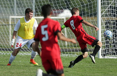 Aaron Ruffner (8) of Huntley score his second goal on goalie Jon Paul Franco (24) of Huntley during the first half of their game at Marian Central Catholic High School on Wednesday, August 24, 2016 in Woodstock, Ill. The Red Raiders defeated the Hurricanes 4-1.  John Konstantaras photo for the Northwest Herald