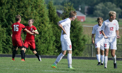 Aaron Ruffner (8) of Huntley celebrates his first goal with Zack Whitaker (16) during the first half of their game against Marian Central Catholic on Wednesday, August 24, 2016 in Woodstock, Ill. The Red Raiders defeated the Hurricanes 4-1.  John Konstantaras photo for the Northwest Herald