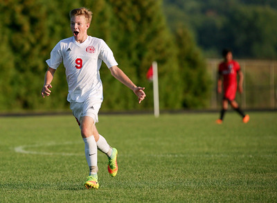 Sam Guilbeault (9) of Marian Central Catholic celebrates his goal during the second half of their game against Huntley at Marian Central Catholic High School on Wednesday, August 24, 2016 in Woodstock, Ill. The Red Raiders defeated the Hurricanes 4-1.  John Konstantaras photo for the Northwest Herald