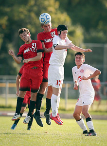 Andrew Meyer (21) of Huntley, Johnny Galason (22) and Connor Stiscak (17) of Marian Central jump for a header during the second half of their game at Marian Central Catholic High School on Wednesday, August 24, 2016 in Woodstock, Ill. The Red Raiders defeated the Hurricanes 4-1.  John Konstantaras photo for the Northwest Herald