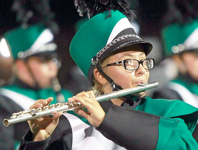 Candace H. Johnson Grayslake Central's Sonia Badash plays her flute with the Marching Band at half-time during the football game against Vernon Hills at Grayslake Central High School.