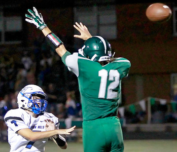 Candace H. Johnson Vernon Hills quarterback Jack Himel throws a pass against Grayslake Central's Jude Witkowski in the third quarter at Grayslake Central High School.