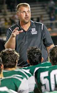 Candace H. Johnson Grayslake Central's Jason Schaal, head coach, talks with his football players after their game against Vernon Hills at Grayslake Central High School.