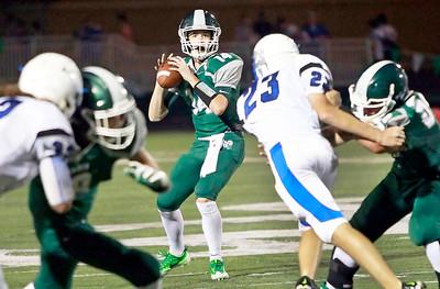 Candace H. Johnson Grayslake Central quarterback, Sam Lennartz, looks to pass against Vernon Hills in the second quarter at Grayslake Central High School.