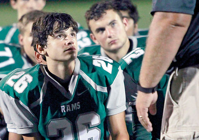 Candace H. Johnson Grayslake Central's Brian Federico listens to Coach Jason Schaal with his teammates after their football game against Vernon Hills at Grayslake Central High School.