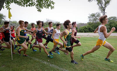 Runners take the first turn in the boys varsity race during the McHenry County Cross Country Meet at Emricson Park on Saturday, August 27, 2016 in Woodstock, Ill.  John Konstantaras photo for the Northwest Herald