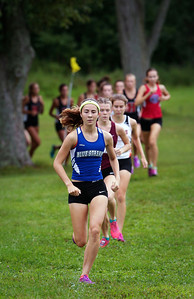 Woodstock's Kate Jacobs leads the pack early in the girls varsity race at the McHenry County Cross Country Meet at Emricson Park on Saturday, August 27, 2016 in Woodstock, Ill. Jacobs finished in second place with a time of 19:31.7.  John Konstantaras photo for the Northwest Herald
