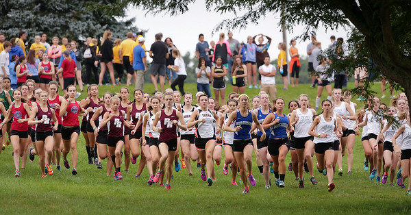 Varsity girls break from the start of the McHenry County Cross Country Meet at Emricson Park on Saturday, August 27, 2016 in Woodstock, Ill.  John Konstantaras photo for the Northwest Herald