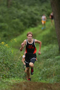 Crystal Lake Central's Weston Sterchi leads the boys varsity race as they head through a wooded area in the McHenry County Cross Country Meet at Emricson Park on Saturday, August 27, 2016 in Woodstock, Ill. Crystal Lake South's Jack Becker won't he race and Sterchi finished in third place.  John Konstantaras photo for the Northwest Herald