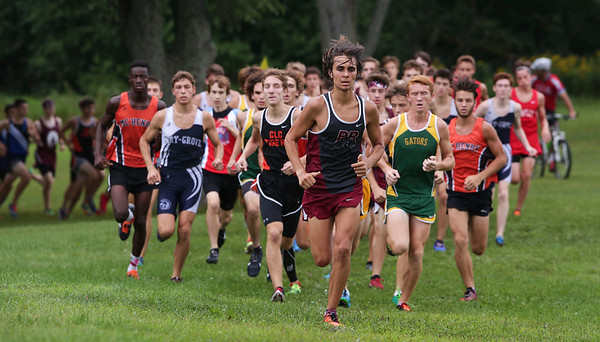 Prairie Ridge's Filip Pajak leads the pack early in the boys varsity race at the McHenry County Cross Country Meet at Emricson Park on Saturday, August 27, 2016 in Woodstock, Ill. Crystal Lake South's Jack Becker won't he race and Pajak finished in fourth place.  John Konstantaras photo for the Northwest Herald