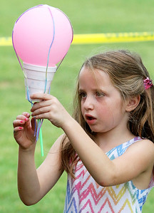 Candace H. Johnson Maria Battaglia, 6, of Arlington Heights works on her balloon craft during the Color Aloft Balloon Festival in Central Park in Grayslake. The craft was sponsored by Old School Montessori in Grayslake.