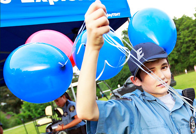 Candace H. Johnson Jeffrey Myhra, 14, of Antioch, a Law Enforcement Explorer, passes out balloons during the Color Aloft Balloon Festival in Central Park in Grayslake.