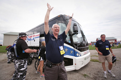 Gordon Stanley, from Schaumburg, a Navy veteran who served in the Korean War is greeted as he steps off the bus for the Veterans of Valor picnic at Stade Farm Market on Saturday, August 27, 2016 in McHenry. The event welcomes home and honors WWll, Korean, and Vietnam veterans arriving back from an Honor Flight to Washington DC with a warrior watch riders escort.  John Konstantaras photo for the Northwest Herald