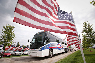 Veterans arrive on a bus escorted by Warrior Watch Riders for the Veterans of Valor picnic at Stade Farm Market on Saturday, August 27, 2016 in McHenry. The event welcomes home and honors WWll, Korean, and Vietnam veterans arriving back from an Honor Flight to Washington DC.  John Konstantaras photo for the Northwest Herald