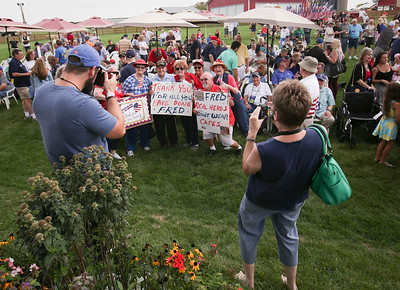Friends and relatives of Fred Prignano, from DeKalb, who served in the Army in the Korean War, pose for a photo with him during the Veterans of Valor picnic at Stade Farm Market on Saturday, August 27, 2016 in McHenry. The event welcomes home and honors WWll, Korean, and Vietnam veterans arriving back from an Honor Flight to Washington DC with a warrior watch riders escort.  John Konstantaras photo for the Northwest Herald