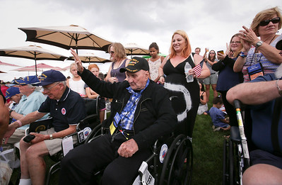 World War II Army veteran Joseph Slavik, 103-years-old from LaGrange Park, acknowledges the crowd as he is honored as the oldest veteran during the Veterans of Valor picnic at Stade Farm Market on Saturday, August 27, 2016 in McHenry. The event welcomes home and honors WWll, Korean, and Vietnam veterans arriving back from an Honor Flight to Washington DC with a warrior watch riders escort.  John Konstantaras photo for the Northwest Herald