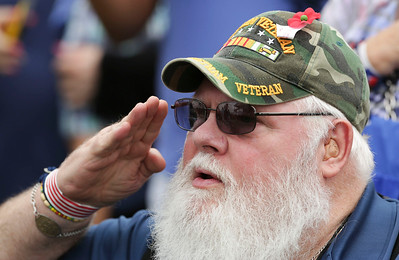 Howard Fritz from Streamwood, who served in the Navy in Vietnam, salutes during the National Anthem during the Veterans of Valor picnic at Stade Farm Market on Saturday, August 27, 2016 in McHenry. The event welcomes home and honors WWll, Korean, and Vietnam veterans arriving back from an Honor Flight to Washington DC with a warrior watch riders escort.  John Konstantaras photo for the Northwest Herald