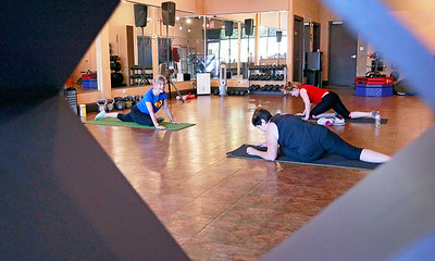 Candace H. Johnson Nancy Hildebrandt, director, (left) leads a small group training session, at Pinnacle Fitness in Libertyville.