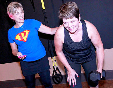 Candace H. Johnson Nancy Hildebrandt, director, works with her client, Jane Collins, of Libertyville, as she lifts weights during a small group training session at Pinnacle Fitness in Libertyville.