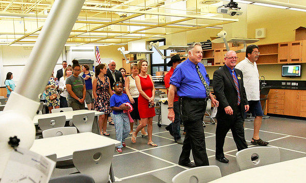 Candace H. Johnson A group of people walk through the new Science Lab on a tour after the ribbon cutting ceremony at Round Lake High School.
