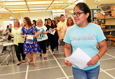 Candace H. Johnson Senior Laura Caballero, 17, with the Panther Crew, gives a tour of the new Science Lab after the ribbon cutting ceremony at Round Lake High School.