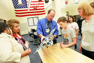 Candace H. Johnson Charlie Adkins, science teacher, talks with Ammon McLane, 11, of Round Lake Beach about building a plane out of Lego and problem based learning in the new Project Lead the Way engineering classroom after the ribbon cutting ceremony at Round Lake High School.