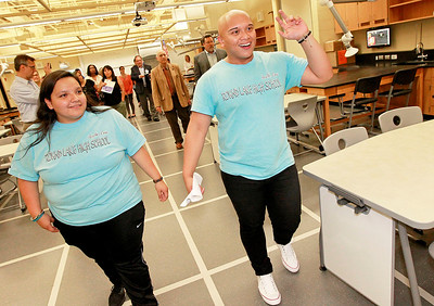 Candace H. Johnson Carla Carrillo, 16, and Jeff Silvestre, 17, both of Round Lake give a tour of the new Science Lab after the ribbon cutting ceremony at Round Lake High School.