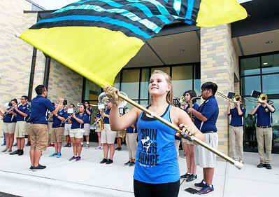 Candace H. Johnson Taylor Hay, 16, of Round Lake Heights performs with the Color Guard and Marching Panthers before the ribbon cutting ceremony and tour at Round Lake High School.