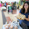 Danielle Fajardo holds an apple pie inside her Knead Crumb and Crust booth at the Batavia Farmers' Market on Aug. 27.