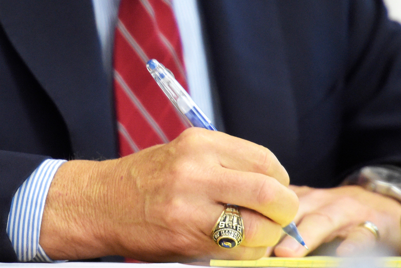 Woodstock Mayor Dr. Brian Sager takes notes during a city council meeting on Tuesday, Aug. 1, 2017, while a resident speaks during a public hearing on a proposed sales tax increase. The proposal suggests a 1 percent increase on sales tax and would bring the local sales tax to 8 percent.