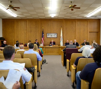Woodstock Mayor Dr. Brian Sager opens up the city council meeting to public hearing Tuesday, Aug. 1, 2017 to hear comments from the public about a proposed 1 percent increase in sales tax. The tax increase would bring sales tax in Woodstock to 8 percent.