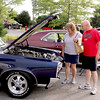 Jim and Caroyln Kinman of Sugar Grove check out a 1966 Pontiac GTO on July 20 at the Rock & Roll Roadshow at McDonalds in Sugar Grove.