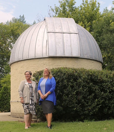 Mary Edith Butler and Lorrie Stahl, the Dean and Assistant Dean of Mathematics and Sciences, respectively, at Waubonsee Community College stand outside of the observatory on the Sugar Grove Campus on July 20. The college recently refurbished the Sugar Grove Observatory this fall. A solar eclipse will be visible Aug. 21.