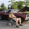 Sugar Grove resident Dennis Fitzpatrick sits by his 1969 Chevy Nova during the Rock & Roll Roadshow at McDonalds in Sugar Grove on July 20.