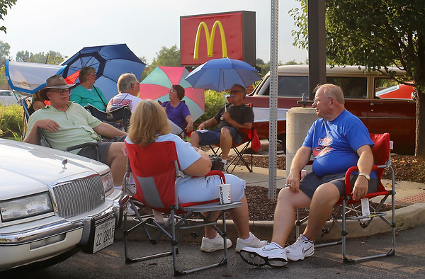 Umbrellas are used to combat the sun and heat on July 20 at the McDonalds in Sugar Grove during the Rock & Roll Roadshow.