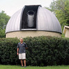 Mike Wlison, adjunct instructor who currently teaches astronomy classes at WCC, stands outside of the observatory with the shutter open which reveals the telescopes at Waubonsee Community College Sugar Grove Campus on July 21.  The college recently refurbished the Sugar Grove Observatory this fall. A solar eclipse will be visible Aug. 21.