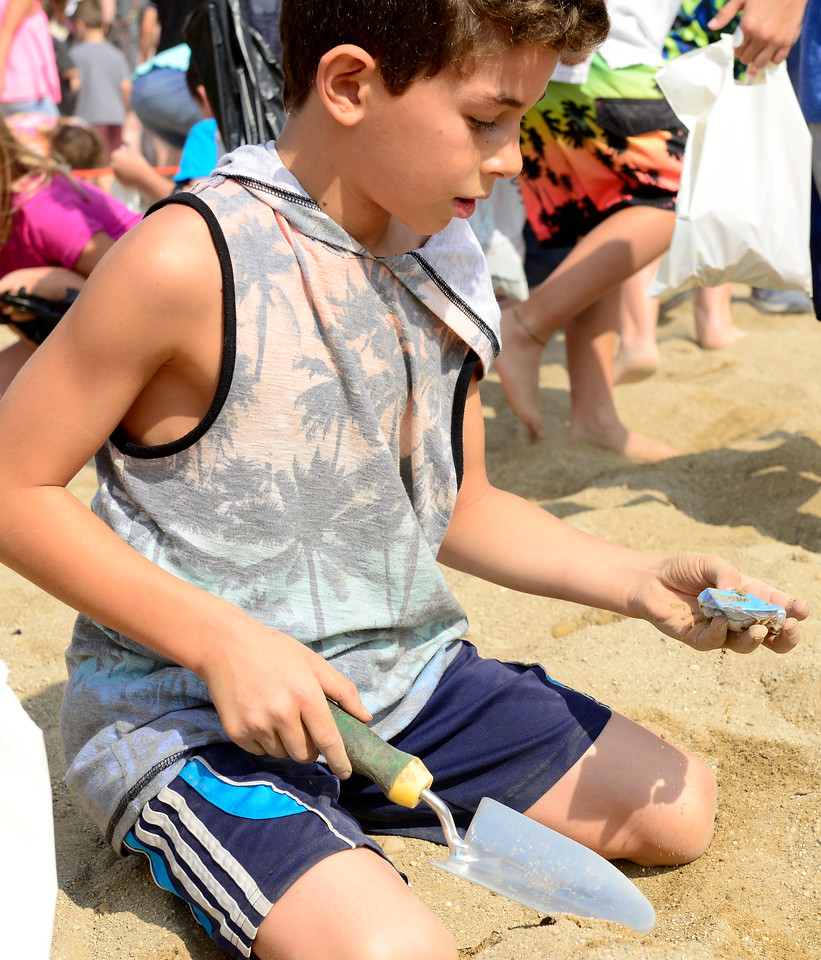 Kayla Wolf - for Shaw Media Andrew Kakish (cq) finds a treat in the sand Saturday, Aug. 5, 2017, during Blast on the Beach in Crystal Lake. The event was sponsored by the Crystal Lake Park District and Crystal Lake Chrysler Jeep Dodge Ram and included a fun fair, craft fair, drinks and food, a treasure hunt and live music.