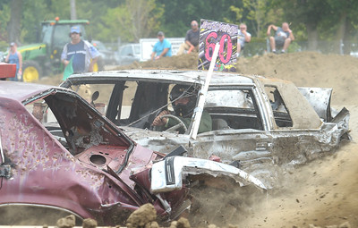 Kayla Wolf - for Shaw Media Demolition derby driver Paul Finefield crashes into another car Sunday, Aug. 6, 2017, at the McHenry County Fair in Woodstock.