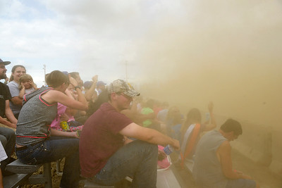 Kayla Wolf - for Shaw Media A cloud of dust rolls over the crowd during the demolition derby at the McHenry County Fair on Sunday, Aug. 6, 2017, in Woodstock. There were two demolition derbies on Sunday a 1 p.m. and a 5 p.m. show.