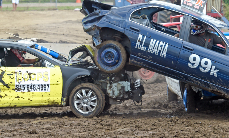 Kayla Wolf - for Shaw Media Demolition derby drivers Keith Whittington, right, and Dante Clemons compete Sunday, Aug. 6, 2017, at the McHenry County Fair in Woodstock.
