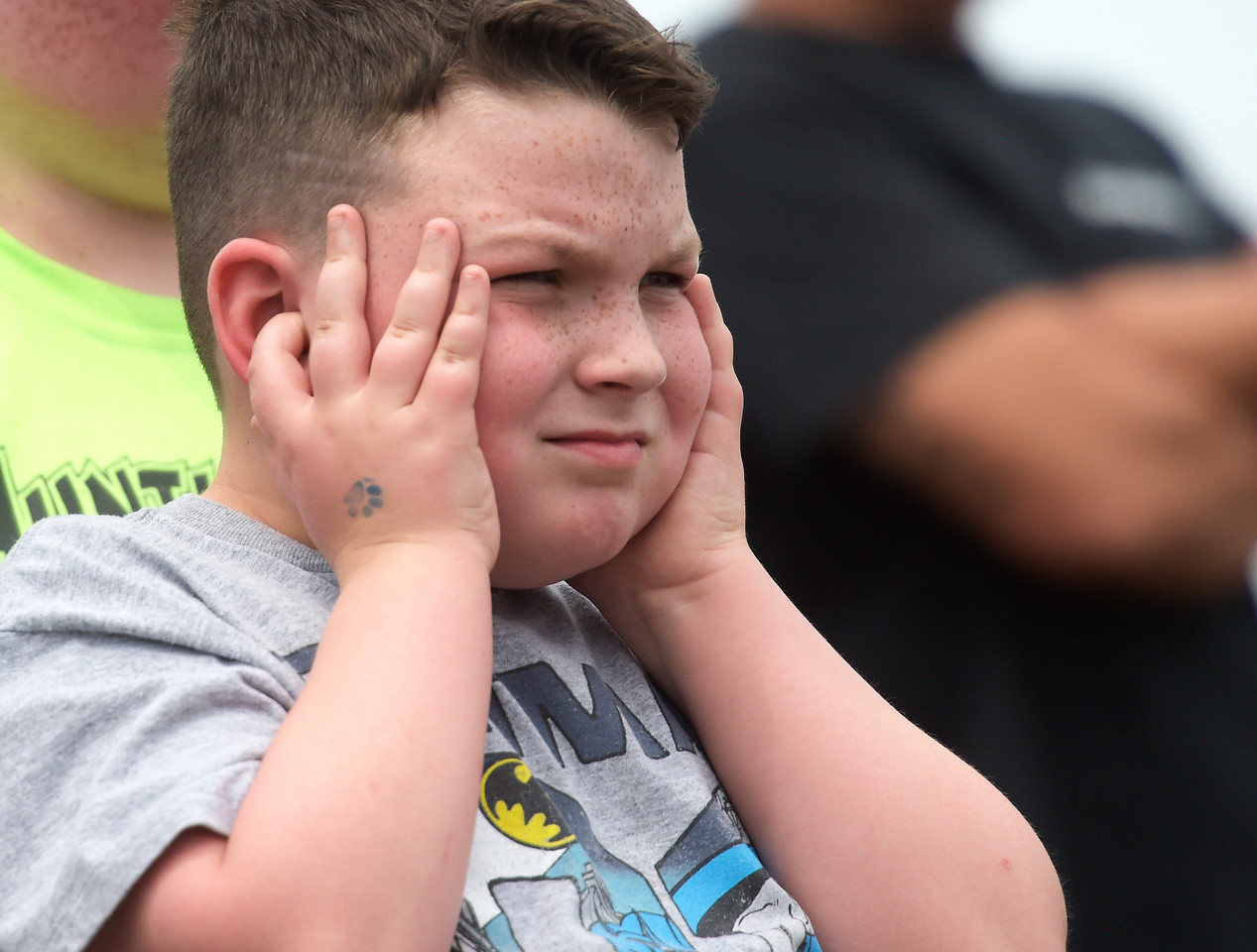 Kayla Wolf - for Shaw Media Nathan Gribbon plugs his ears Sunday, Aug. 6, 2017, during the afternoon demolition derby at the McHenry County Fair in Woodstock.