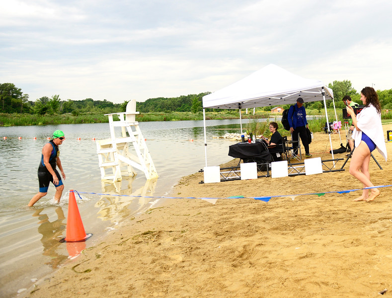 Kayla Wolf - for Shaw Media Laraine Smith exits the water Sunday, Aug. 6, 2017, as Alison Smith takes her picture during the Aquathon at Three Creeks Recreation Area in Crystal Lake. Participants could swim and run the distances of a sprint, olympic or ironman triathlon without having to bike.