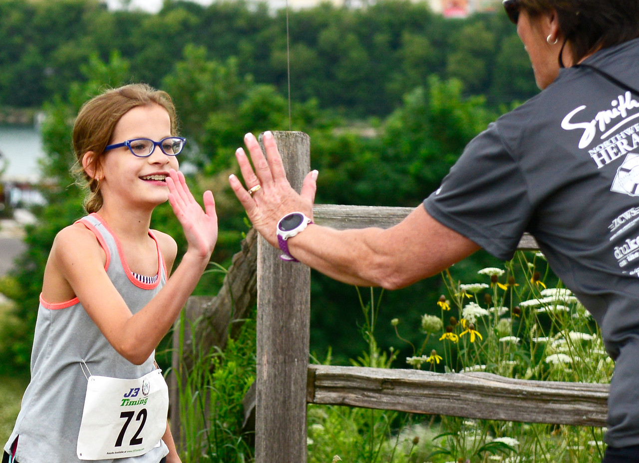 Kayla Wolf - for Shaw Media Cindy Wikierak (cq), right, high-fives Claire Brown during the Aquathon, a swimming and running event  Sunday, Aug. 6, 2017, held at Three Creeks Recreation Area in Crystal Lake.